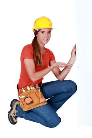 craftswoman: craftswoman showing an ad board