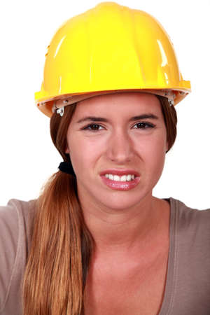 abhorrence: A disgusted tradeswoman Stock Photo