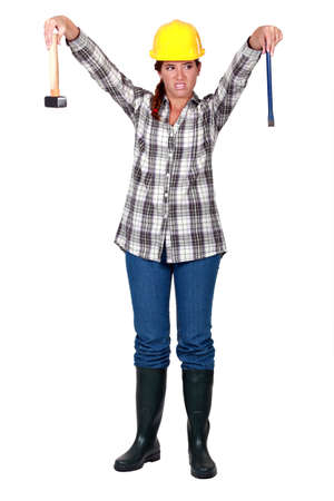 dumping: A female carpenter repulsed by her tools