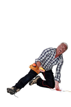 thoughtless: Man being electrocuted Stock Photo