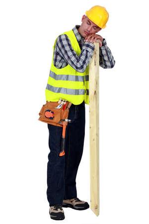 siesta: Carpenter sleeping on the job Stock Photo