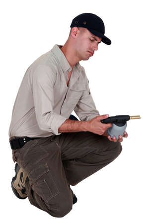 foremaster: craftsman holding a welding torch