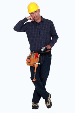 safety: Tradesman holding an angle grinder