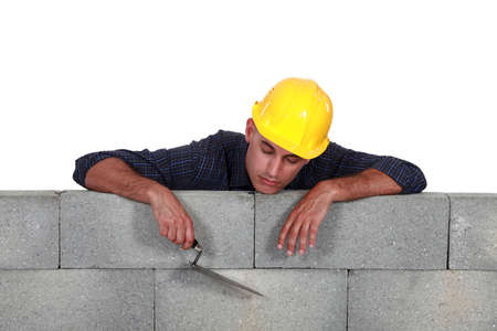 dozing: Tradesman asleep on the job Stock Photo
