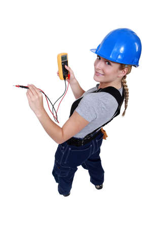 voltmeter: Female electrician with a voltmeter