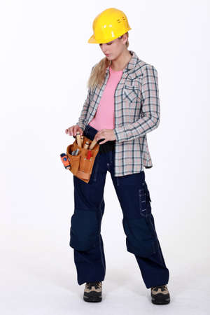 unbiased: female apprentice with toolbelt
