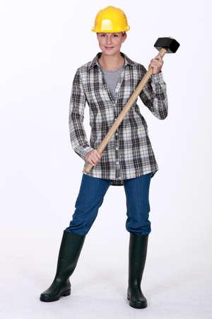 trineo: Mujer con un martillo Foto de archivo