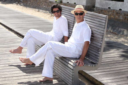 father and son posing together outdoors photo