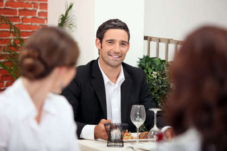 desirous: Handsome man in a restaurant Stock Photo