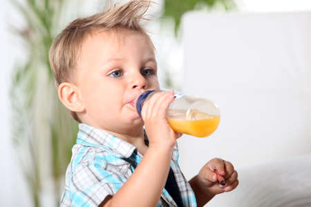 tousled: baby boy having his bottle