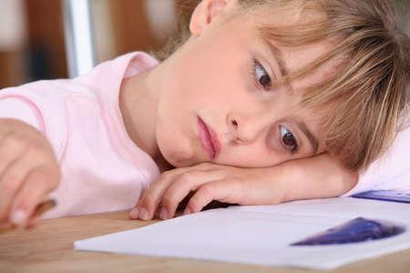 homework student: tired schoolgirl Stock Photo
