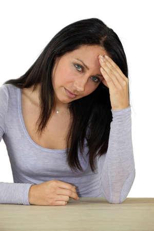vexation: Woman with a headache Stock Photo