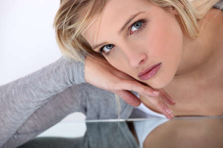 tormented: portrait of young pretty blonde looking serious