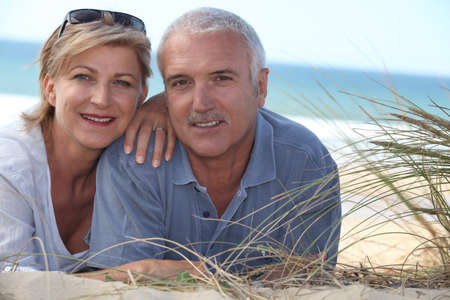Couple lying in the dunes photo