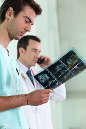 Medics looking at a scan photo