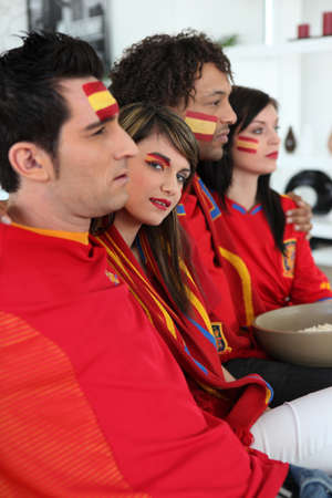 telly: portrait of Spanish supporters watching soccer match on telly