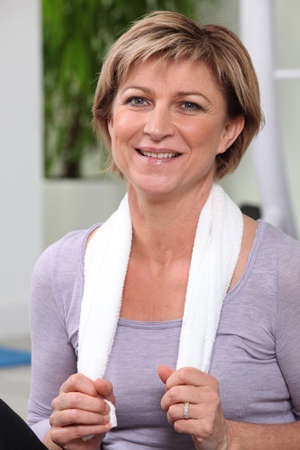 cardiovascular workout: Middle-aged woman stood in gym Stock Photo