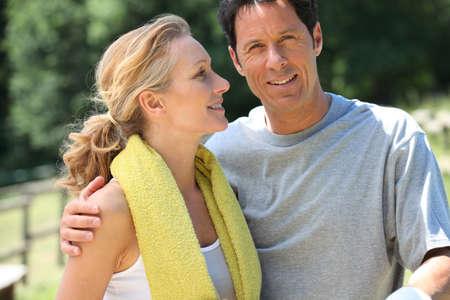 Landscape of mature sporty couple photo