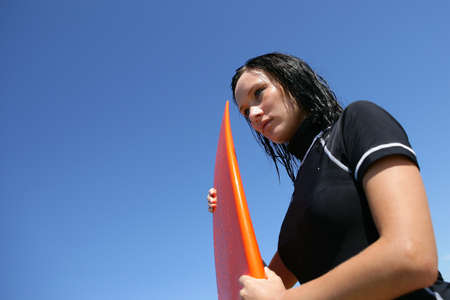 surf girl: Female surfer waiting for the right wave