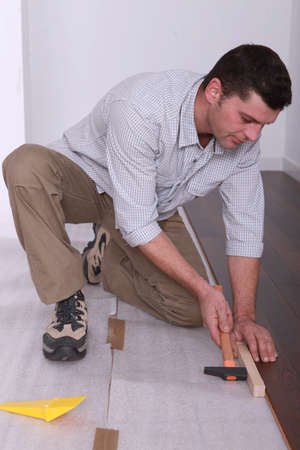 Man laying a wooden floor Stock Photo - 12729134