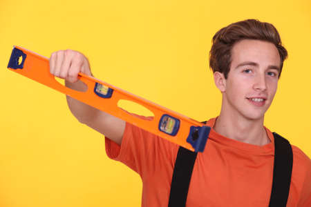 Young man with a spirit level photo