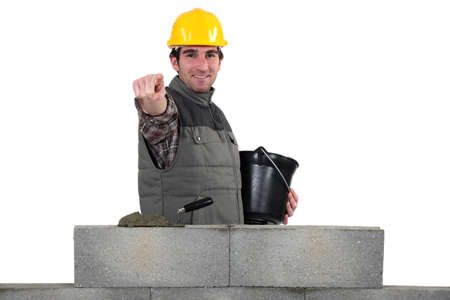 leveling: Bricklayer pointing ahead