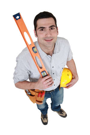 craftsman holding a level Stock Photo - 12912564