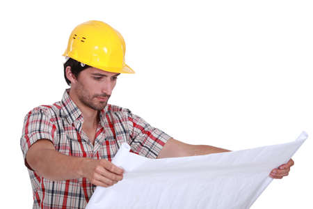 sexy construction worker: A foreman checking plans