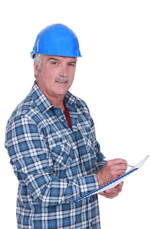 hard bound: Construction foreman evaluating an employee Stock Photo