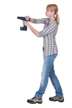 Female DIY fan holding power drill photo