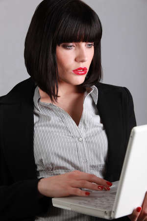 Businesswoman using a laptop photo