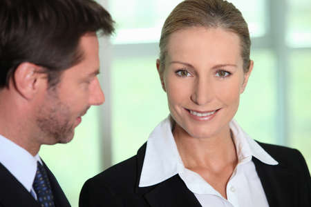 Businessman looking at businesswoman Stock Photo - 12915252