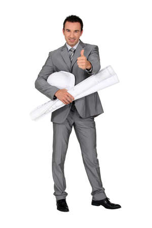Architect with plans and a hard hat Stock Photo - 12909793