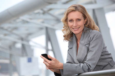 business woman phone: Businesswoman with mobile phone