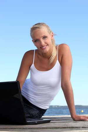 Woman on laptop Stock Photo - 12915135