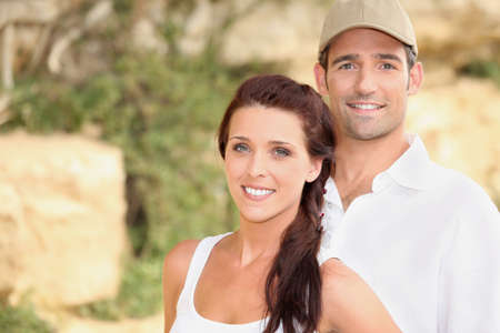 tenacious: Couple stood outdoors by rocks