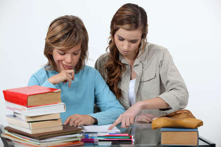 younger: Sister helping her sibling with an assignment