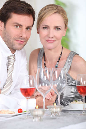 Couple drinking rose wine photo