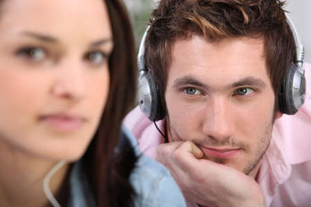 soul mate: man with headphones beholding his belle Stock Photo