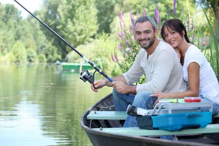 カップル釣り 写真素材