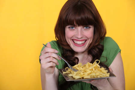 crazy woman: Woman eating tagliatelle Stock Photo