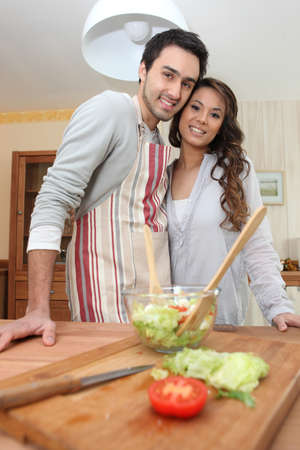 Couple making a salad in the kitchen Stock Photo - 12728054