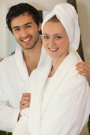 Young couple in bathrobes photo