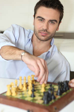 young man playing chess Stock Photo - 12728913