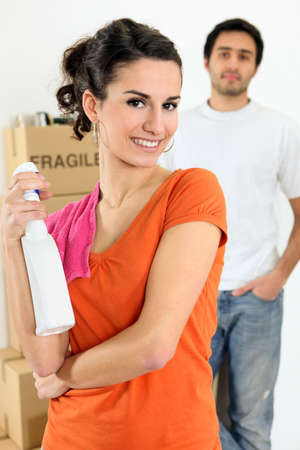 Young woman with cleaner spray in hand Stock Photo - 12596770
