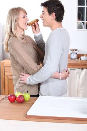 guilty pleasures: Couple eating an eclair