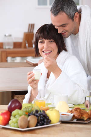 Couple in bathrobe having breakfast photo