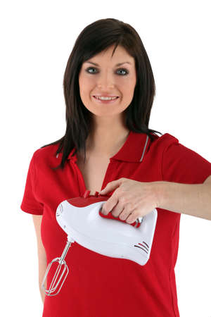 Smiling woman holding electric whip photo