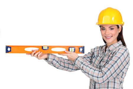 tradeswoman: Tradeswoman holding a spirit level