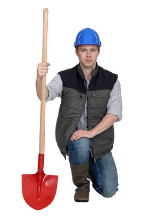 Worker clutching shovel photo